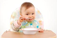 Het eten van babymeisje Stock Foto