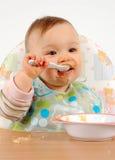 Het eten van babymeisje Stock Foto's