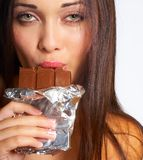 Het eten van chocolade stock foto