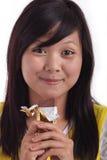 Het eten van chocolade Stock Foto's