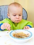 Het eten van de baby Stock Foto's