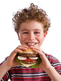 Het eten van de jongen Stock Foto's