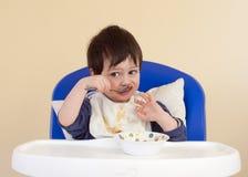 Het eten van de peuter royalty-vrije stock foto