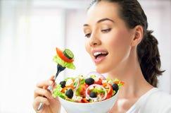 Het eten van gezond voedsel Stock Foto's