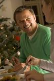 Het eten van het Braadstuk van Kerstmis Stock Foto