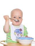 Het eten van kind. Geïsoleerd Stock Foto's