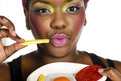 Het eten van snel voedsel Stock Afbeeldingen