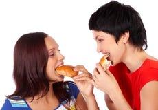 Het eten van vrouwen Stock Afbeeldingen