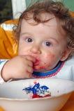 Het eten van weinig jongen Stock Afbeelding