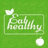 Het etiket eet gezond op groene achtergrond De sticker met het blad royalty-vrije illustratie
