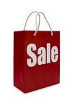Het etiket van de verkoop op rode het winkelen document zak Royalty-vrije Stock Foto