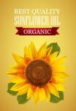Het etiket van de zonnebloemolie met het interessante embleem van n op een gele achtergrond Stock Fotografie