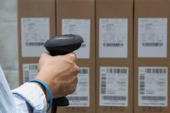Het etiketscanner van de streepjescode met etiket Stock Fotografie