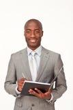 Het etnische zakenman schrijven stock foto