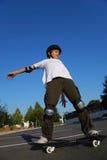 Het in evenwicht brengen van het Skateboard Stock Afbeelding