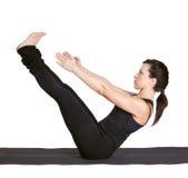 Het excercising van de yoga navasana stock foto