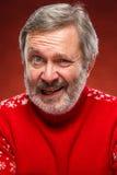 Het expressieve portret op rode achtergrond van een poutermens Stock Foto