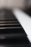 Het extreme dichte omhooggaande detail van het muziektoetsenbord Stock Foto