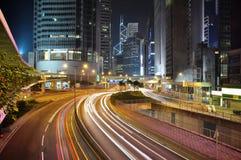 Het financiële district van Hongkong bij nacht Stock Afbeelding
