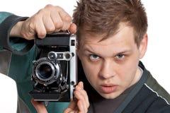 Het fotograferen van oude camera Stock Afbeelding