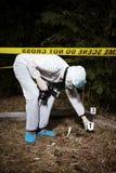 Het fotograferen van plaats van misdaad stock afbeeldingen