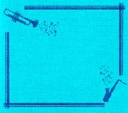 Het frame van de saxofoon en van de trompet op blauw canvas Royalty-vrije Stock Afbeeldingen