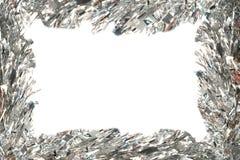 Het frame van Kerstmis met zilverachtig klatergoud royalty-vrije stock afbeeldingen