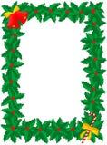Het frame van Kerstmis van hulst met klokken & suikergoedstok Stock Afbeelding