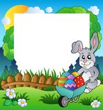 Het frame van Pasen met konijntje en kruiwagen Royalty-vrije Stock Afbeelding