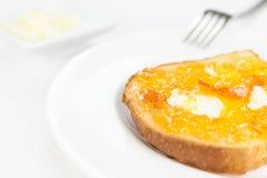 Het Frans roostert dicht omhoog, oranje marmelade en boter Royalty-vrije Stock Foto