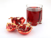 Het fruit van de granaatappel met sap Stock Fotografie