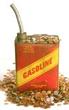 Het gas kan en stapels van geld Stock Foto's