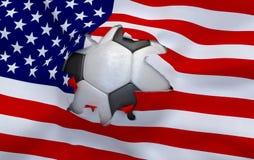 Het gat in de vlag van de V.S. en voetbalbal royalty-vrije stock fotografie