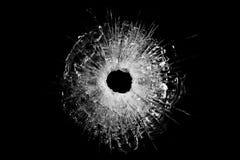 Het geïsoleerdea gat van de kogel in glas stock foto