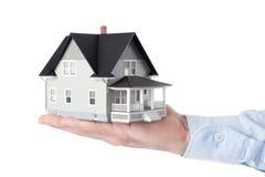 Het geïsoleerdee model van het de holdingshuishouden van de hand, royalty-vrije stock foto's