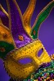 Het geassorteerde masker van Mardi Gras of Carnivale-op een purpere achtergrond Royalty-vrije Stock Foto