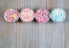 Het geassorteerde suikergoed bestrooit stock afbeeldingen