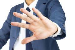 Het Gebaar van zakenmanstop sign hand op Schuine standmening op Whit wordt geïsoleerd die Royalty-vrije Stock Afbeeldingen
