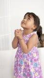 Het gebed van het meisje royalty-vrije stock fotografie