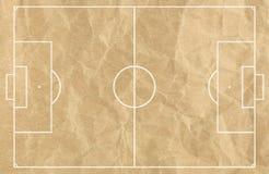 Het gebied van de voetbalvoetbal met witte lijn op oud document Stock Foto's