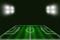 Het gebied van het voetbal met witte lijnen en groen gras Stock Afbeeldingen
