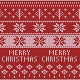 Het gebreide patroon van de Kerstmissweater met deers, sparren, sneeuwvlokken De achtergrond van de de winterstof Royalty-vrije Stock Foto's