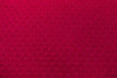 Het gebreide roze van de sweatertextuur stock foto