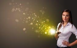 Het gebruiken van telefoon met gouden het fonkelen concept stock foto's