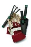 Het gebruikte tuinieren/werkt handschoenen en hulpmiddelen Royalty-vrije Stock Afbeelding