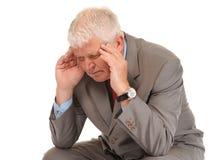 Het gedeprimeerde rijpe hoofd van de zakenmanholding Royalty-vrije Stock Afbeelding