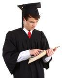 Het gediplomeerde bekijken een boek Stock Foto