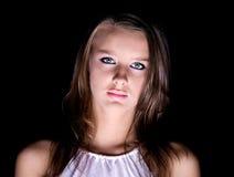 Het geheimzinnige licht van het vrouwenportret van onderaan stock fotografie