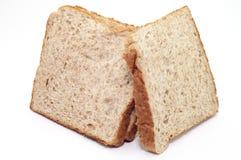 HET GEHELE KORRELbrood OP WITTE ACHTERGROND Stock Foto's
