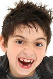 Het gekke Dichte Omhooggaande Kind van het Gezicht Royalty-vrije Stock Afbeeldingen